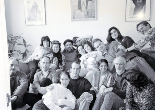 Photo of a dozen CEML activists in living room with Luis Talamantez